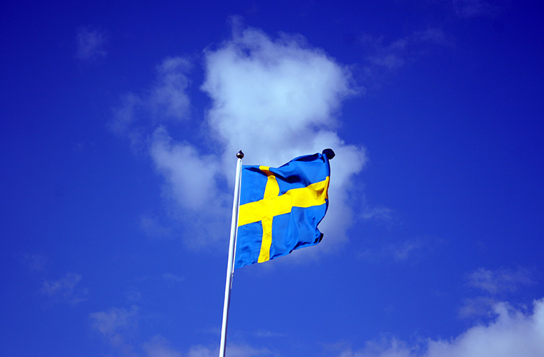 Swedish_flag_with_blue_sky_behind